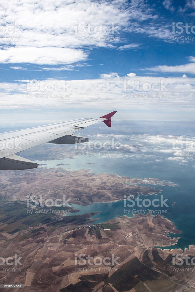 Aerial view Istanbul, plane wing from airplane window stock photo