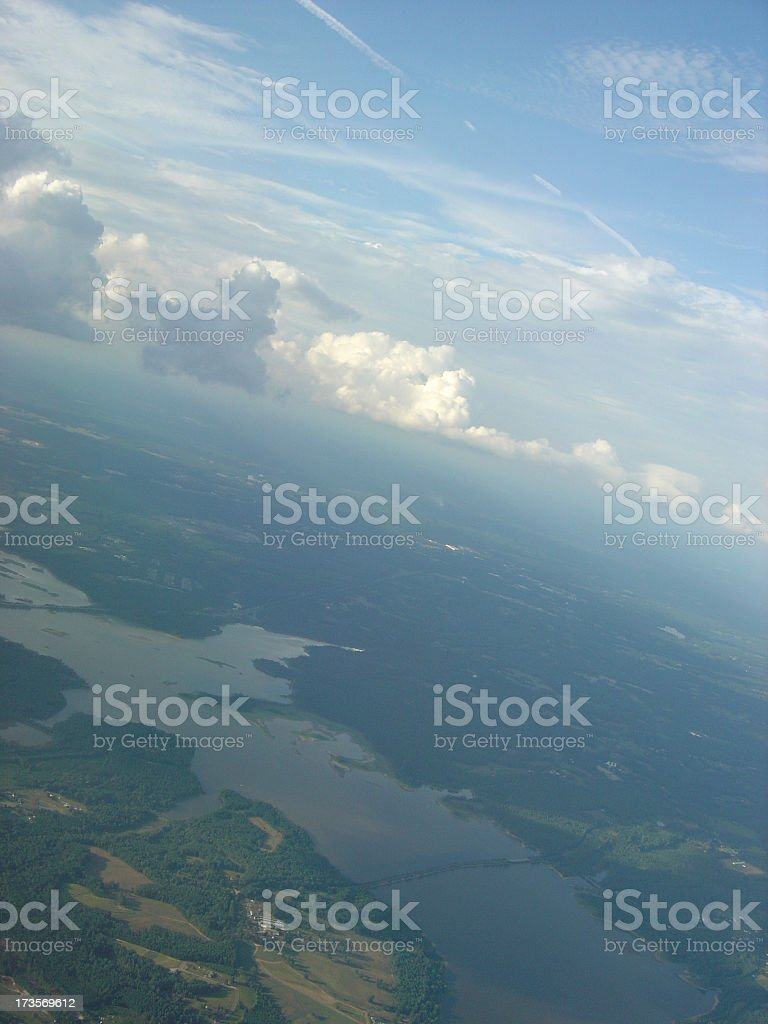 Aerial View looking at Body of Water, Land, and Cloudscape royalty-free stock photo