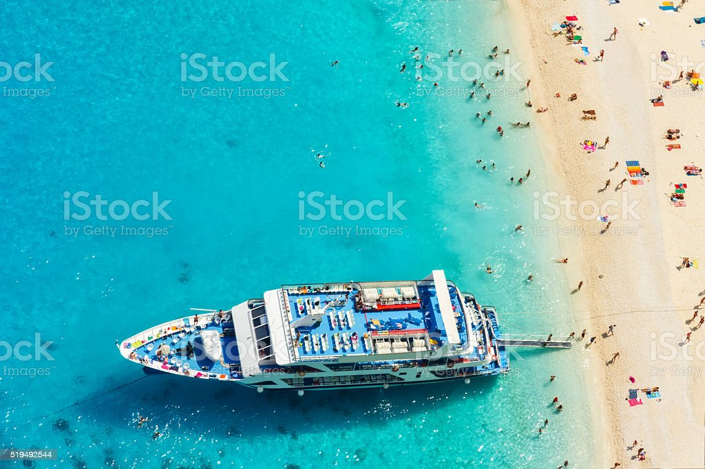 Aerial view of a beach with big boat and people stock photo