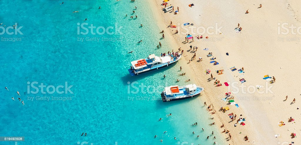 Aerial view of a beach with motorboats and people stock photo