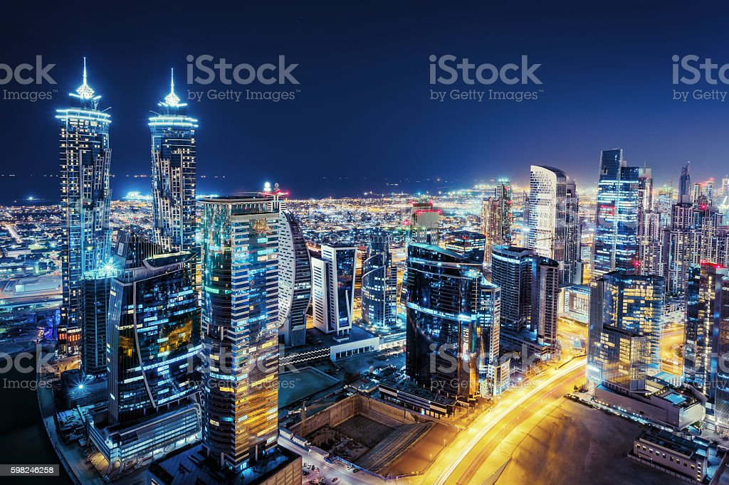 Aerial view of a big futuristic city by night. stock photo