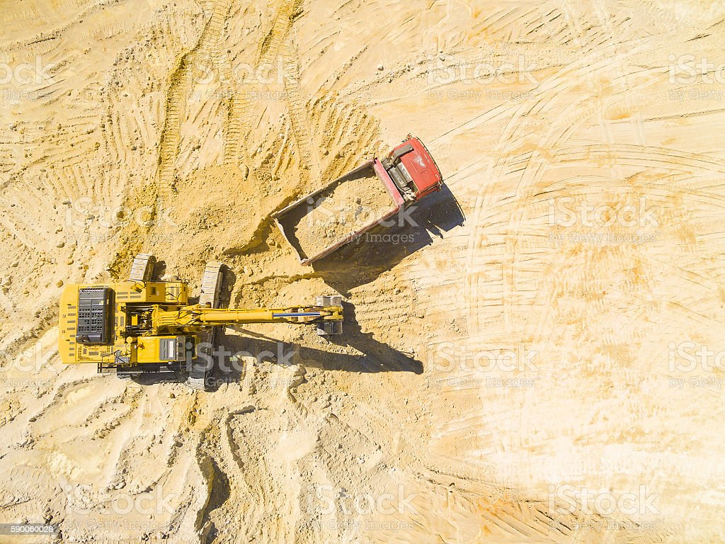 Aerial view of a excavator and truck. stock photo
