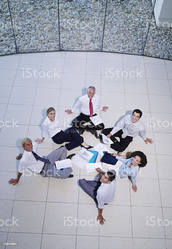Aerial view of a group of office workers meeting in a rotunda stock photo