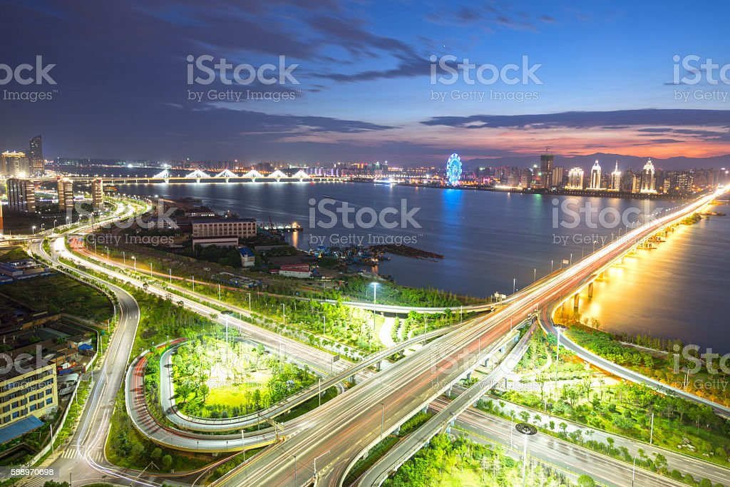 Aerial view of a highway overpass at night in Shanghai stock photo