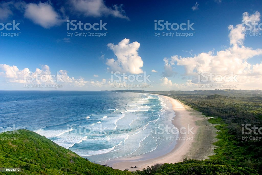 Aerial view of a large beach showing waves on a sunny day royalty-free stock photo