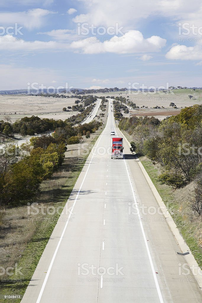 Aerial view of a long flat four lane highway with traffic stock photo