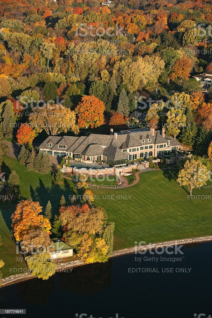 Aerial view of a luxury lake home in Autumn. stock photo