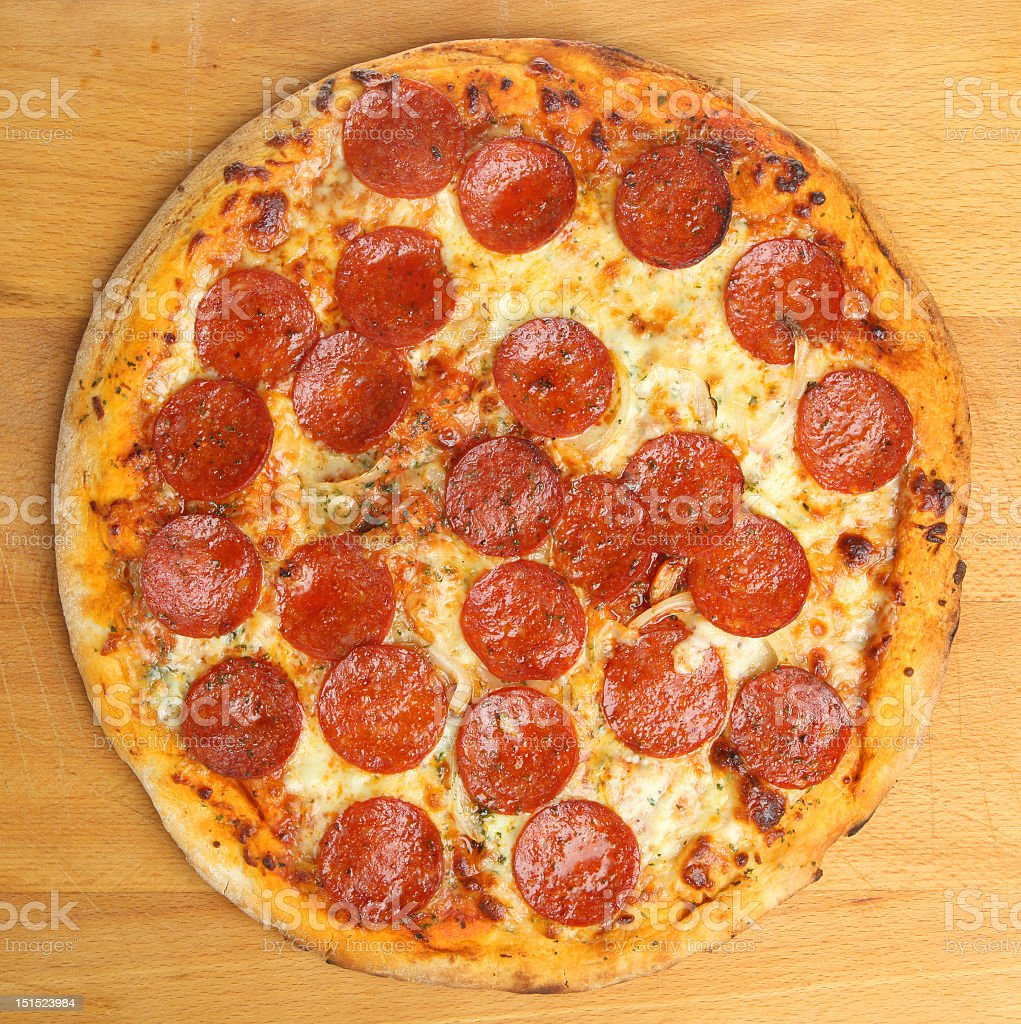 Aerial view of a pepperoni pizza stock photo