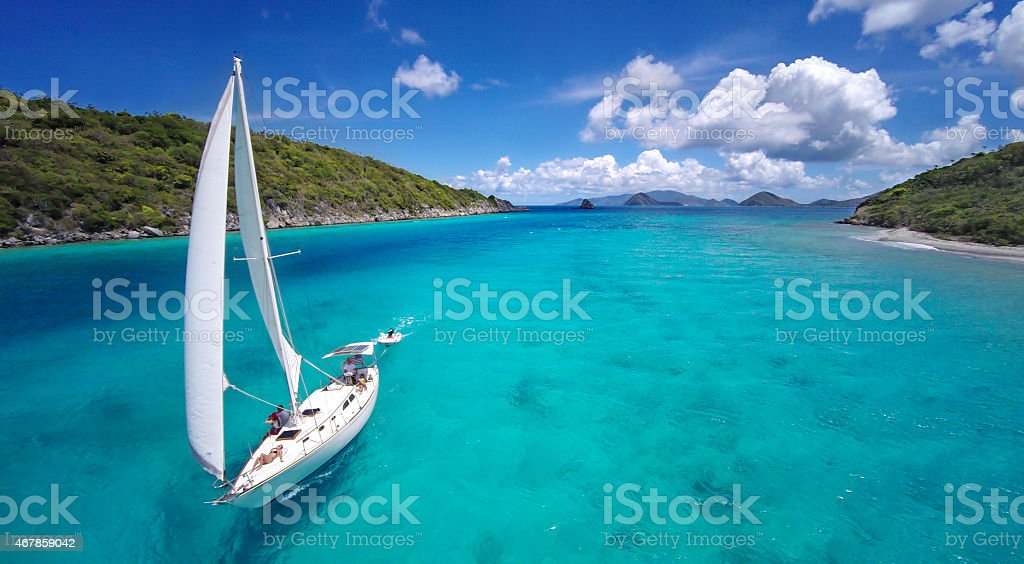aerial view of a sailboat travelling through the Caribbean stock photo