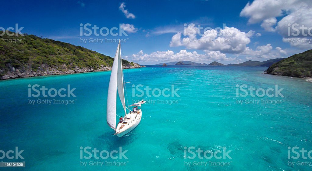 aerial view of a sloop sailing through the Caribbean stock photo