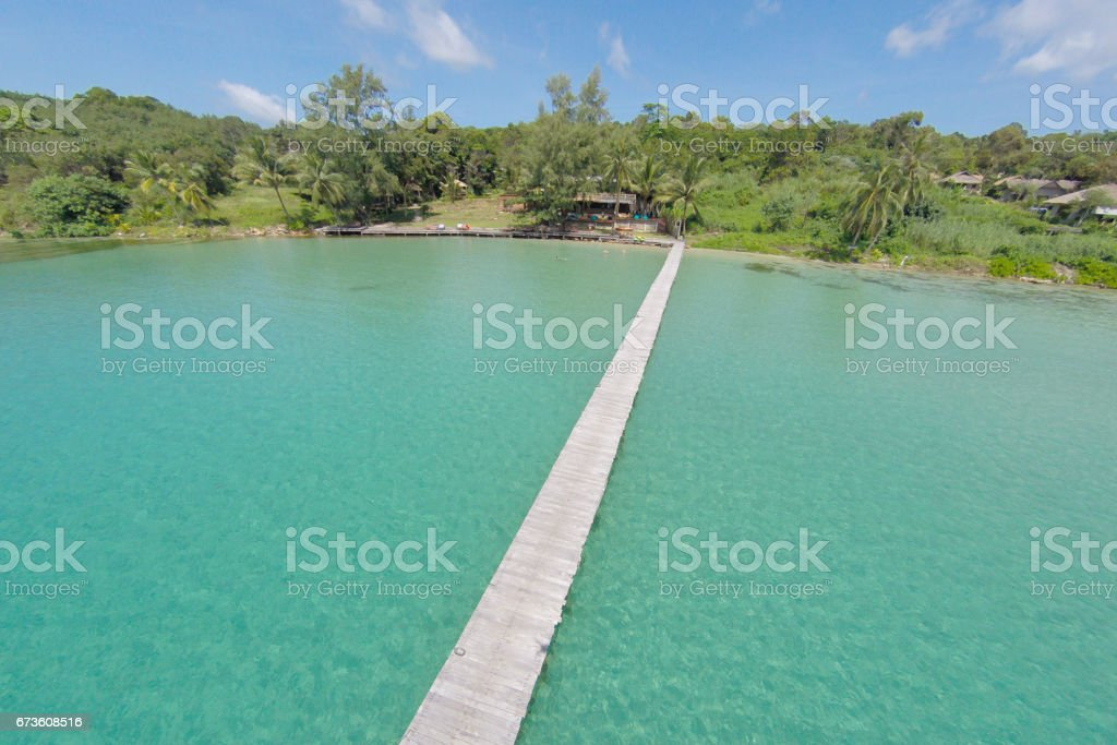 Aerial view of a tropical island in turquoise water. Luxurious over-water villas on tropical Kood island, for holiday vacation background concept -Boost up color Processing. stock photo