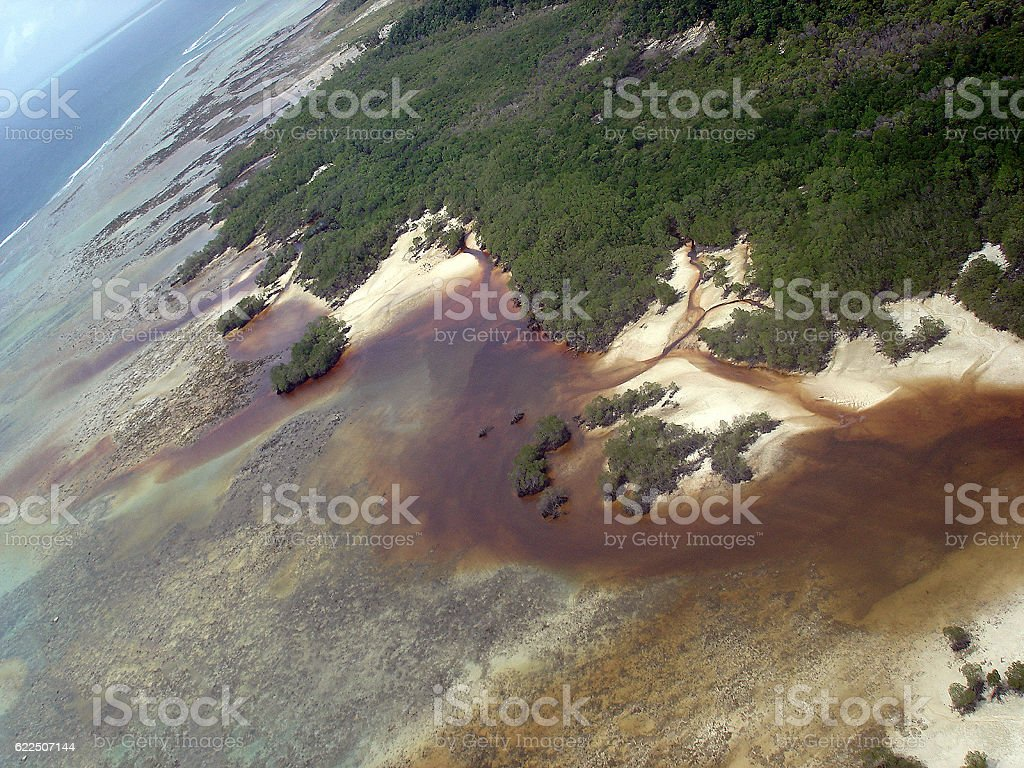 Aerial view of a tsunami affected island. stock photo