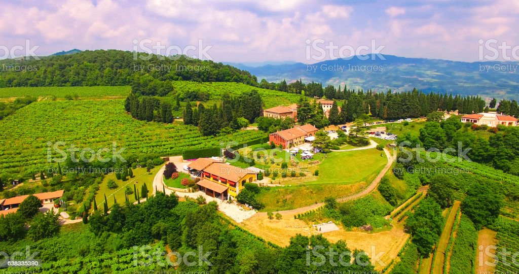 Aerial view of an old farmhouse in the hills. stock photo