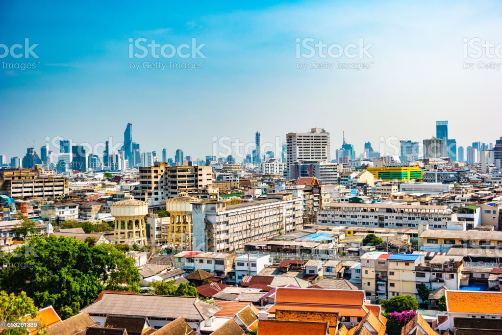 Aerial view of Bangkok monastery and modern office buildings stock photo