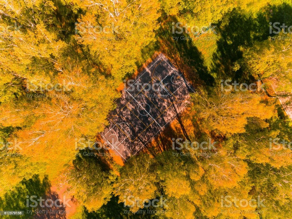 Aerial view of basketball field on day time in forest. Above with drone. stock photo