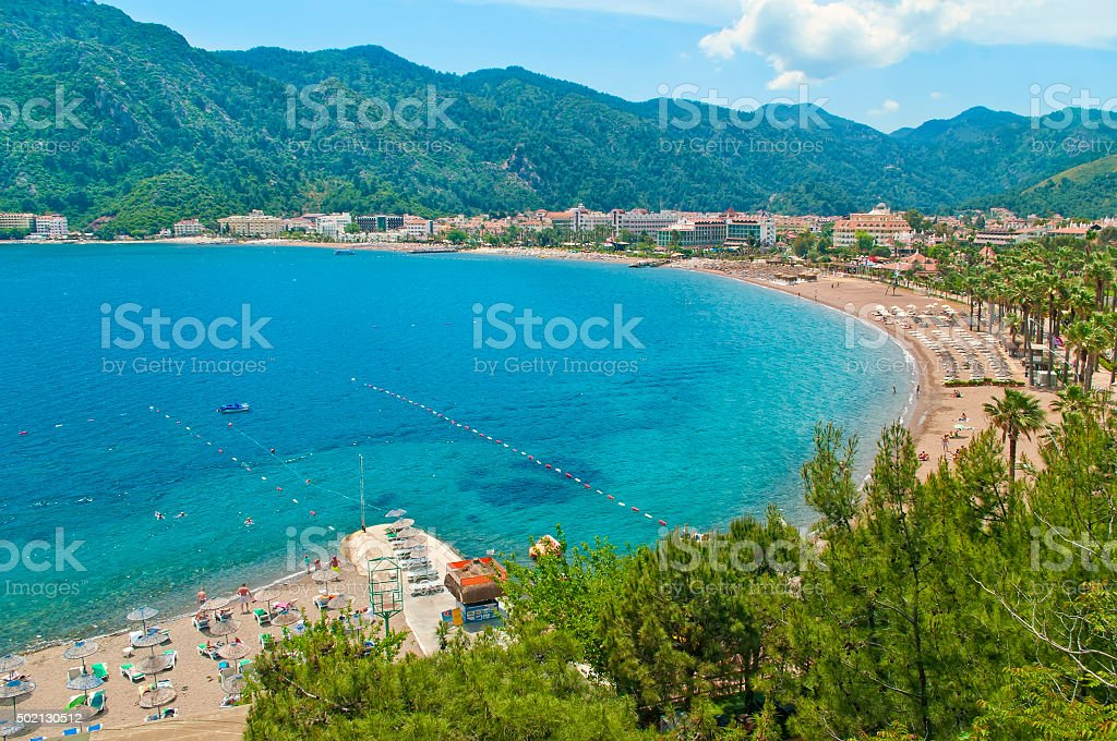 aerial view of beach and resorts with mountains around stock photo