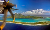 Aerial view of Bora Bora island and airplane propeller