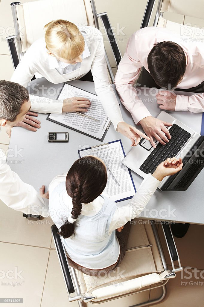 Aerial view of business partners conversing stock photo