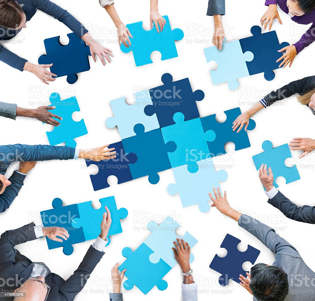 Aerial View of Business People Piecing Puzzle Pieces stock photo