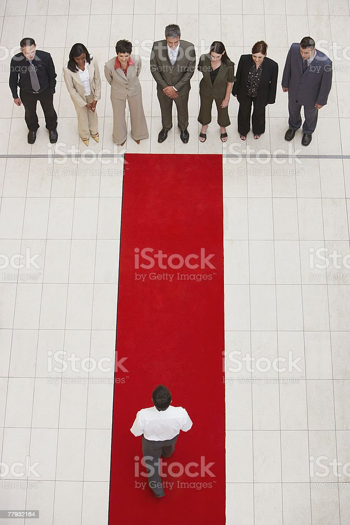 Aerial view of businesspeople and man on red carpet stock photo