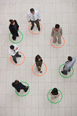 Aerial View of businesspeople standing in circles