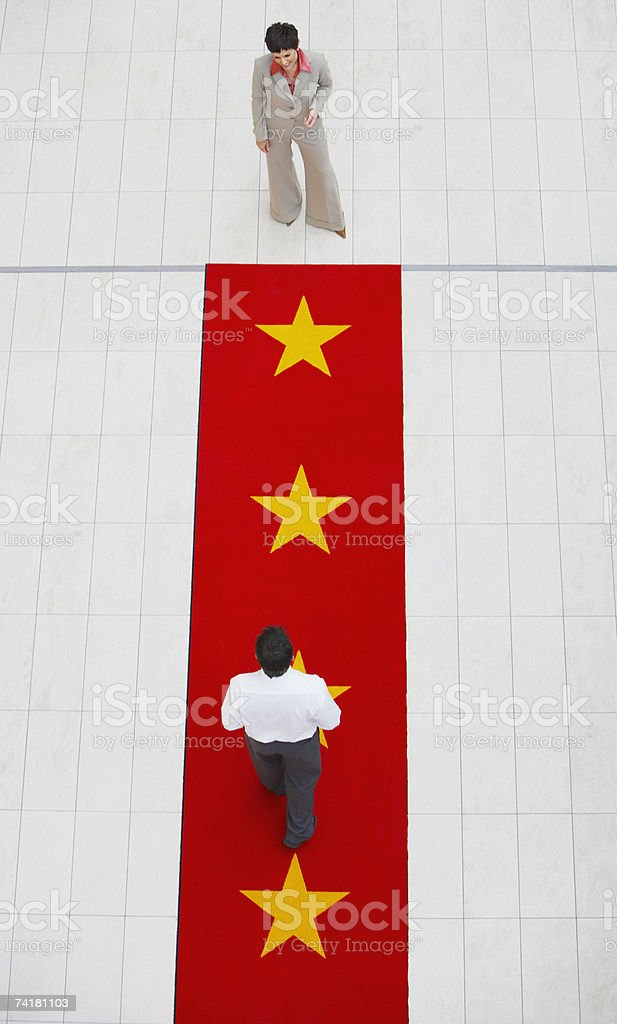 Aerial view of businesswoman and man with red carpet stock photo