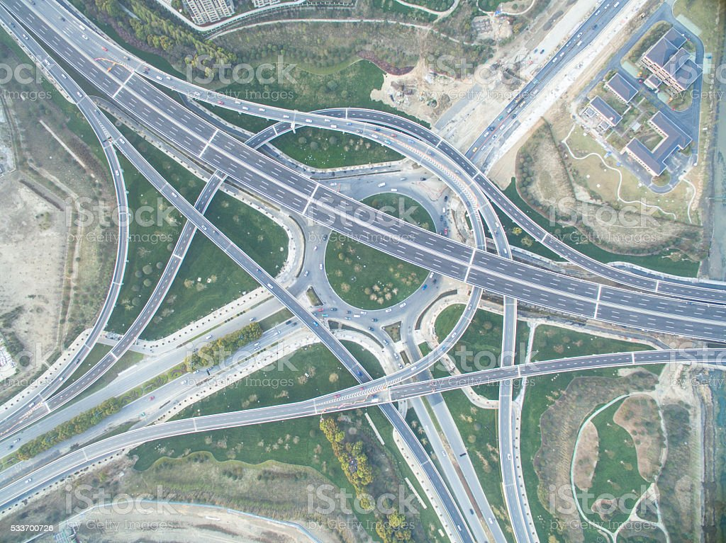 aerial view of busy traffic on road junction stock photo
