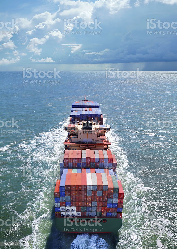 Aerial view of cargo ship on the sea stock photo