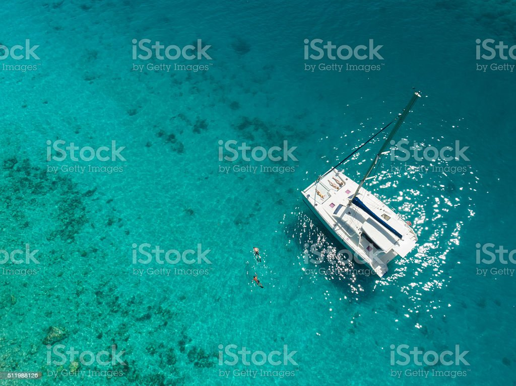 Aerial view of catamaran anchored in tropical Caribbean stock photo