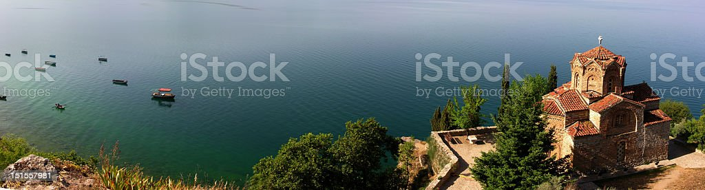 Aerial view of church by body of water stock photo