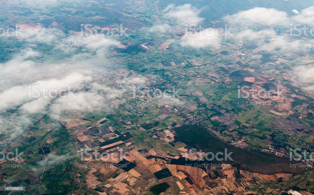Aerial view of city through airplane window stock photo