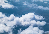 Aerial view of cloud and sky from airplane window