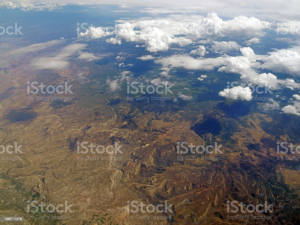 Aerial view of clouds and mountains landscape from an airplane stock photo