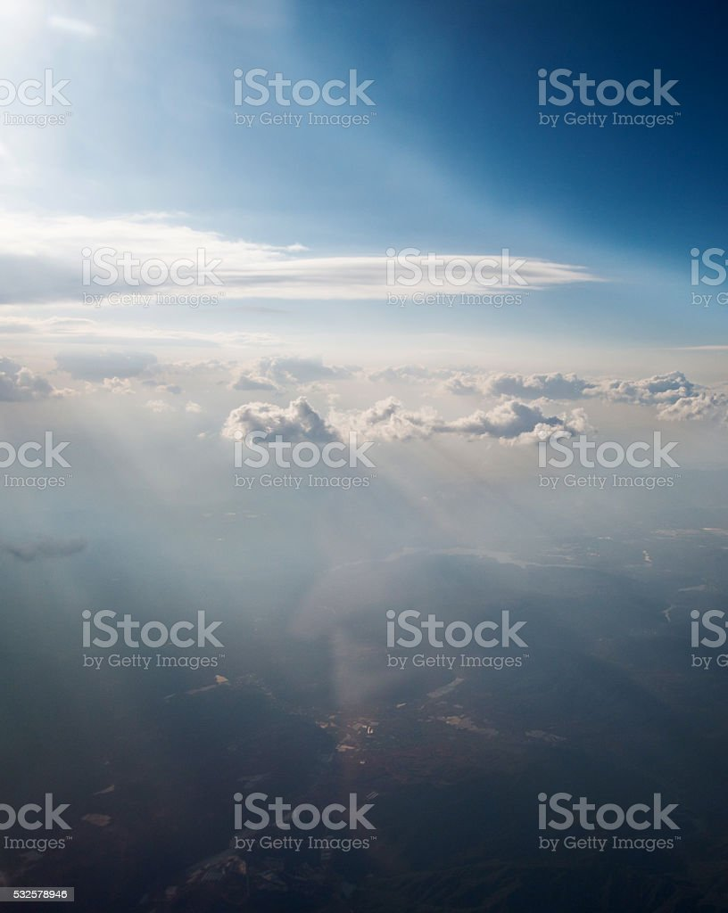 Aerial view of cloudscape with sun rays stock photo