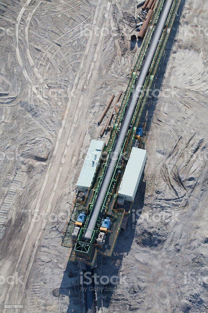 aerial view of coal mine conveyor belt stock photo