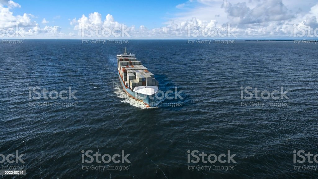 Aerial view of container ship sailing in the sea stock photo