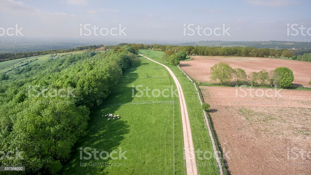 Aerial view of countryside ploughed farm field, springtime green meadow stock photo