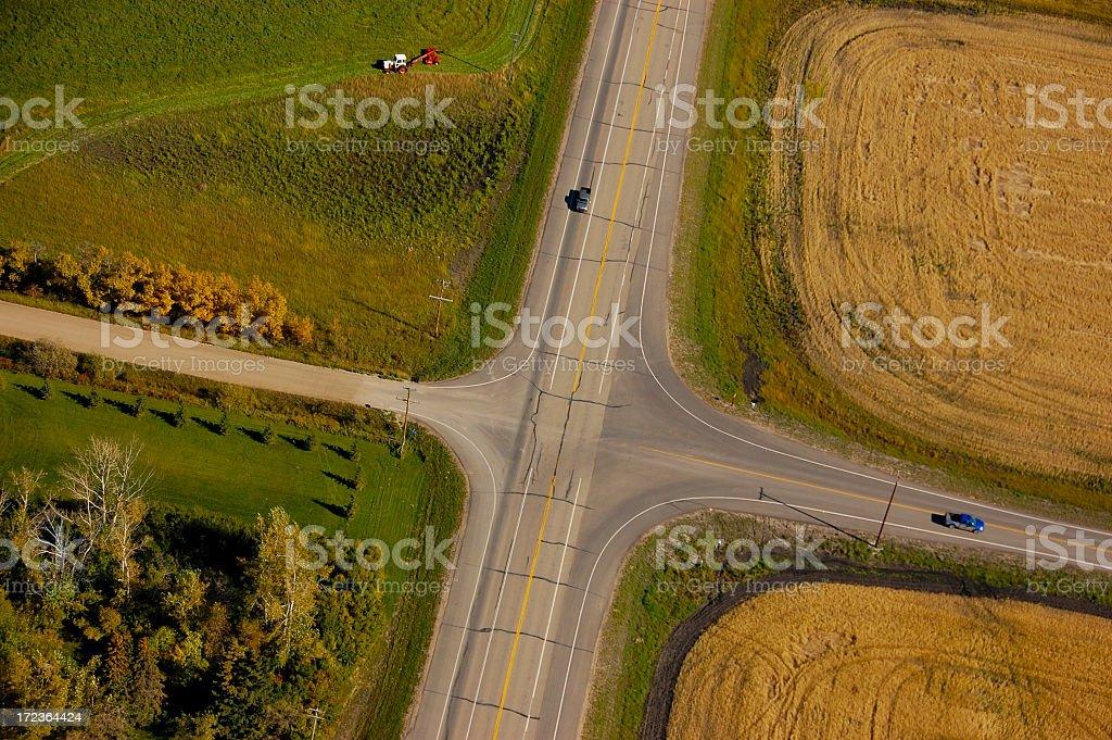 Aerial view of crossroads between rural land stock photo