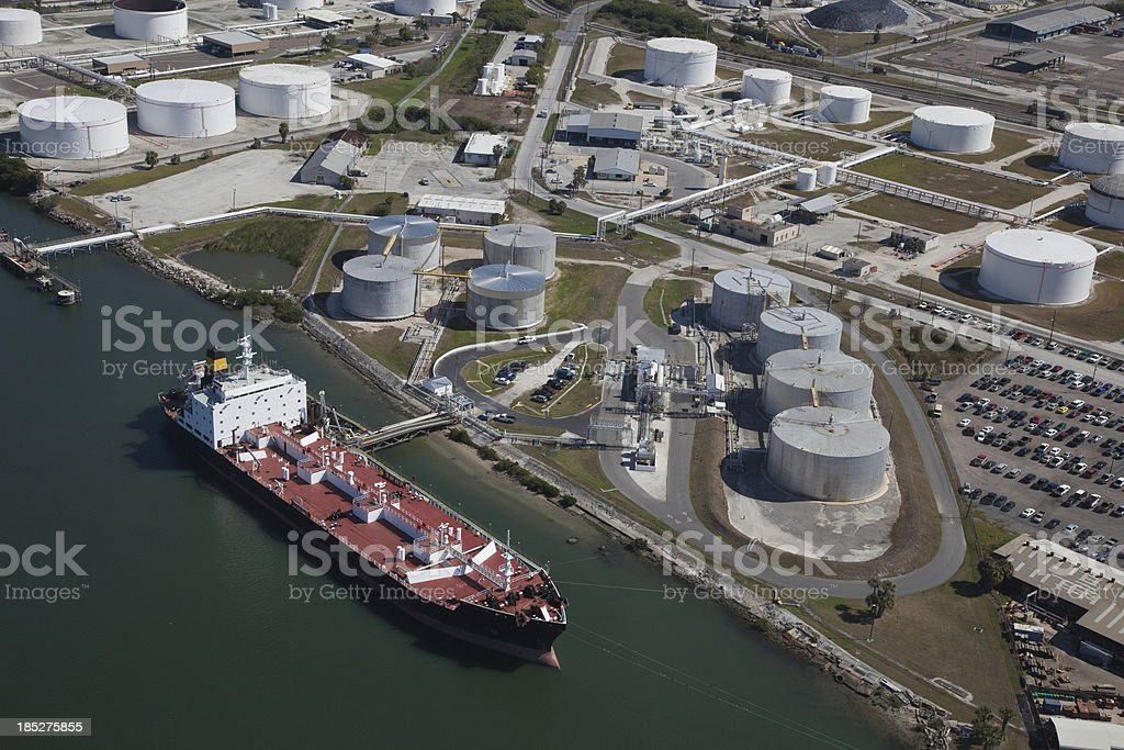 Aerial View of Crude Oil Tanker and Storage Tanks stock photo