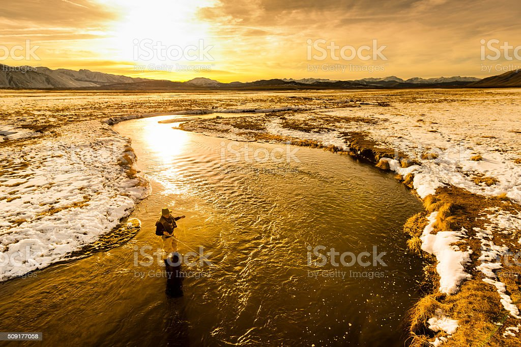 Aerial View Of Flyfisherman In the River At Sunset stock photo