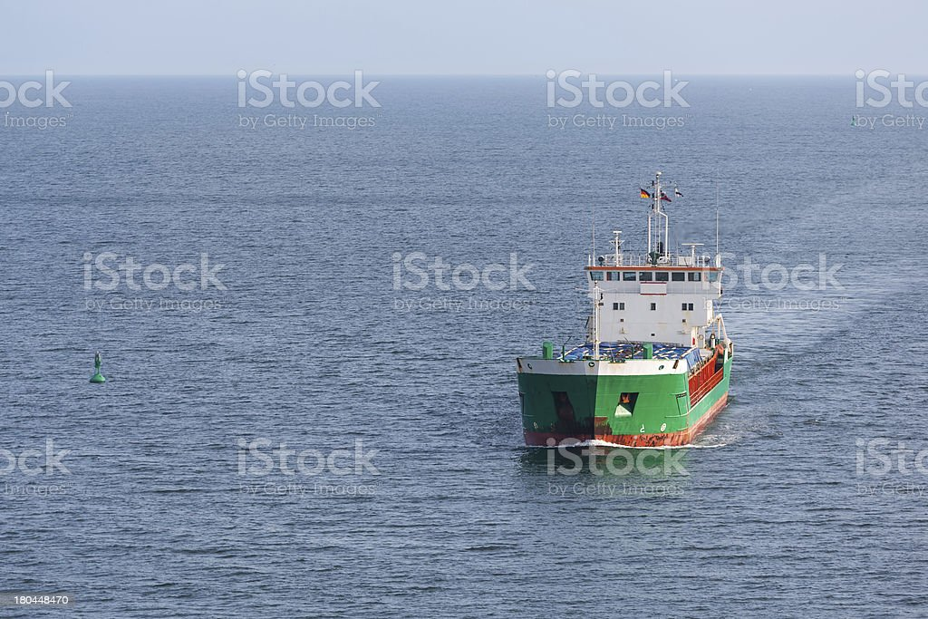 Aerial view of freighter sailing at the big blue sea royalty-free stock photo