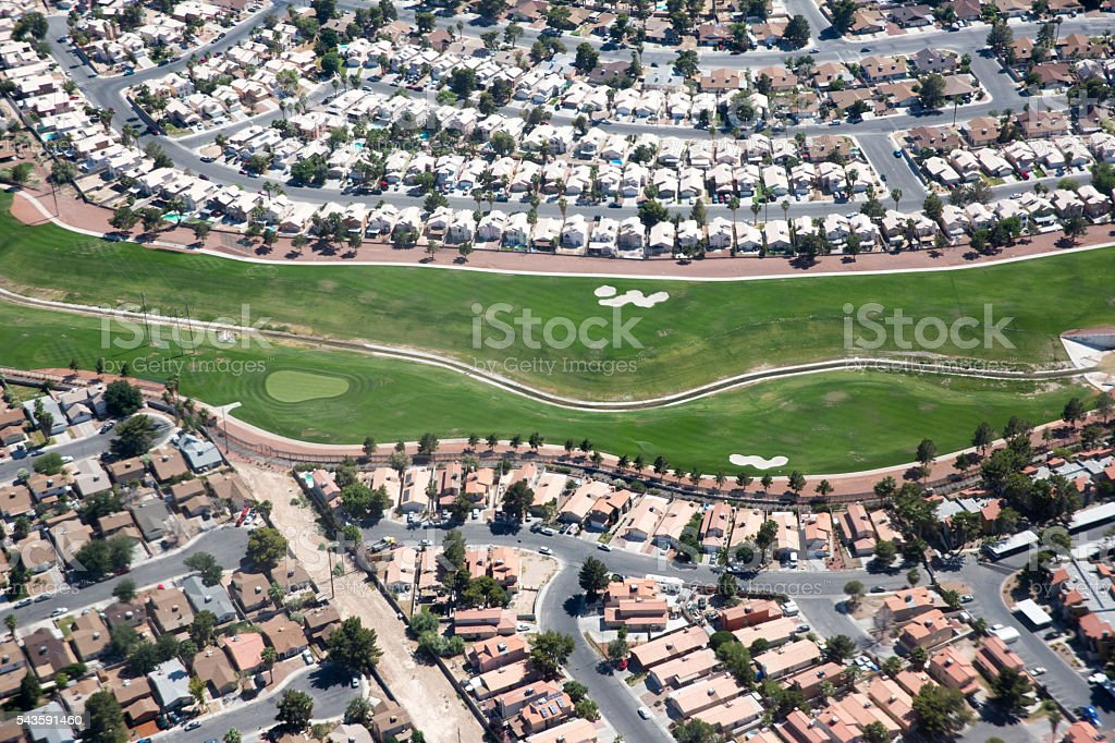 Aerial view of golf course surrounded by homes stock photo