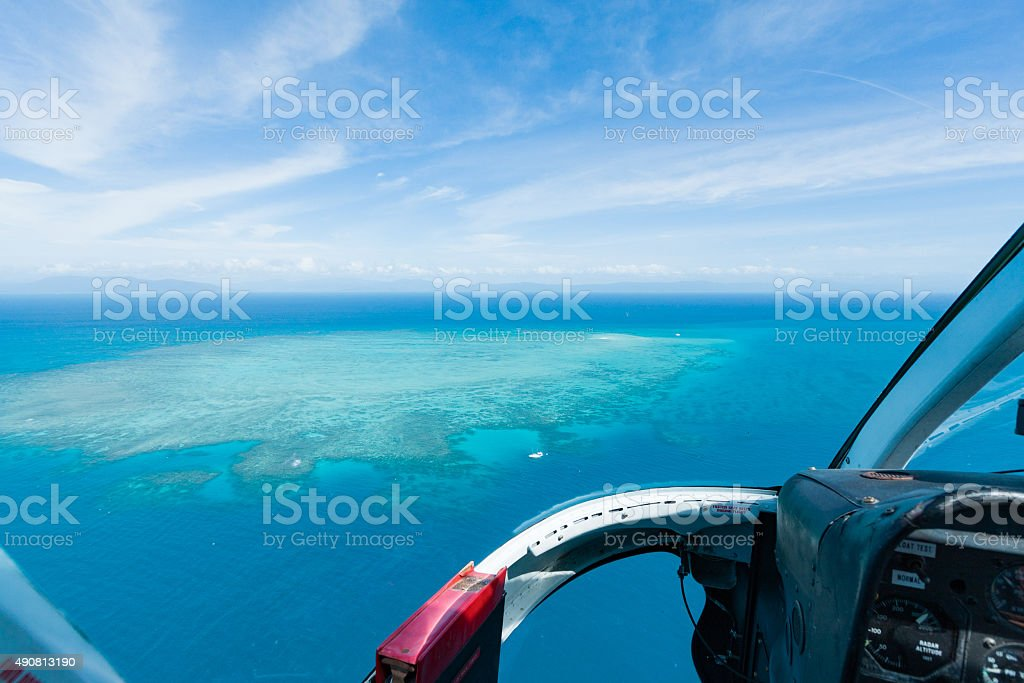 Aerial view of Great Barrier Reef from helicopter with cockpit stock photo