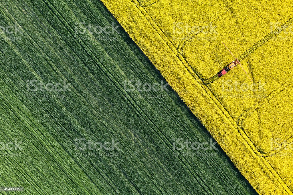 aerial view of harvest fields with tractor stock photo