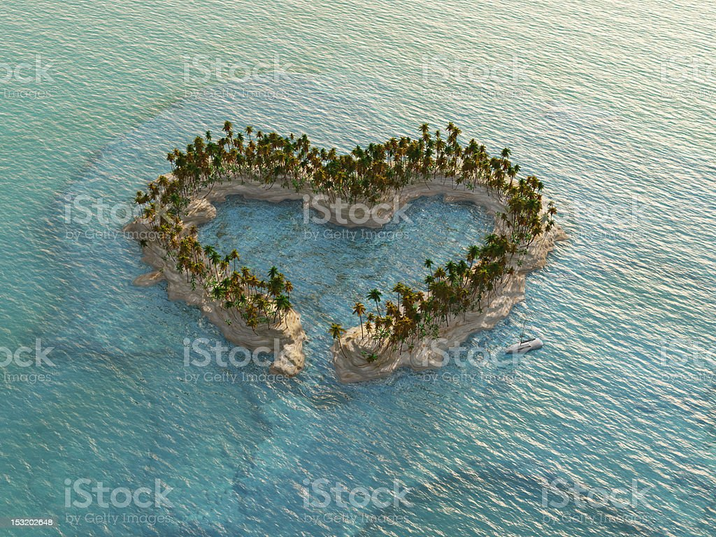 aerial view of heart-shaped tropical island stock photo