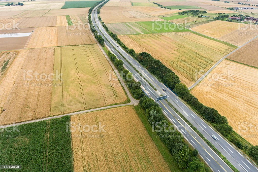 Aerial view of highway and fields stock photo