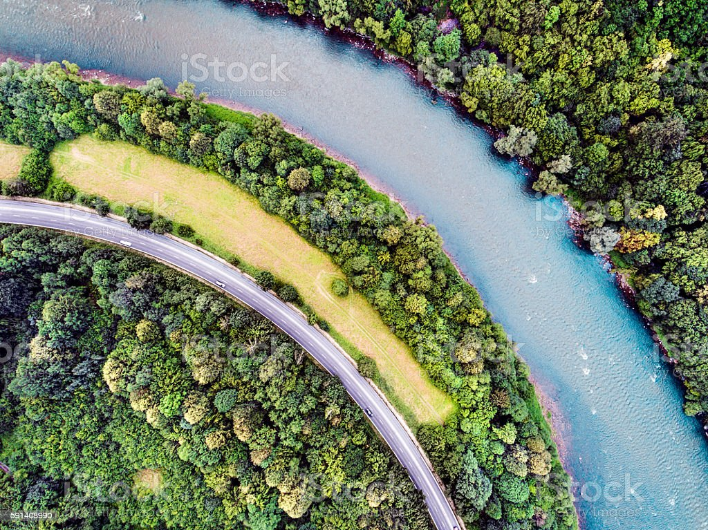 Aerial view of highway, river, forest and grassland stock photo