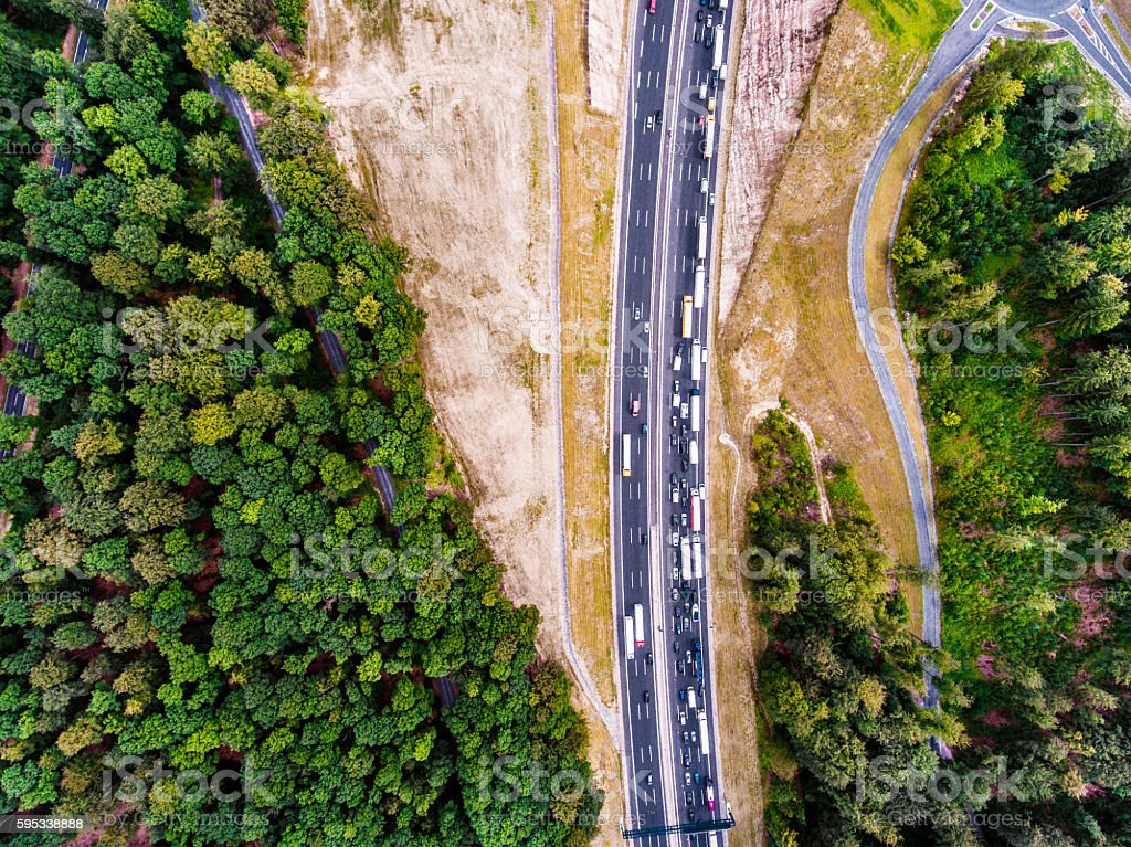 Aerial view of highway, traffic jam, green forest, Netherlands stock photo