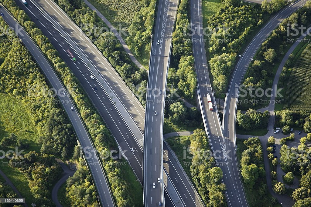 Aerial view of highways through green nature stock photo