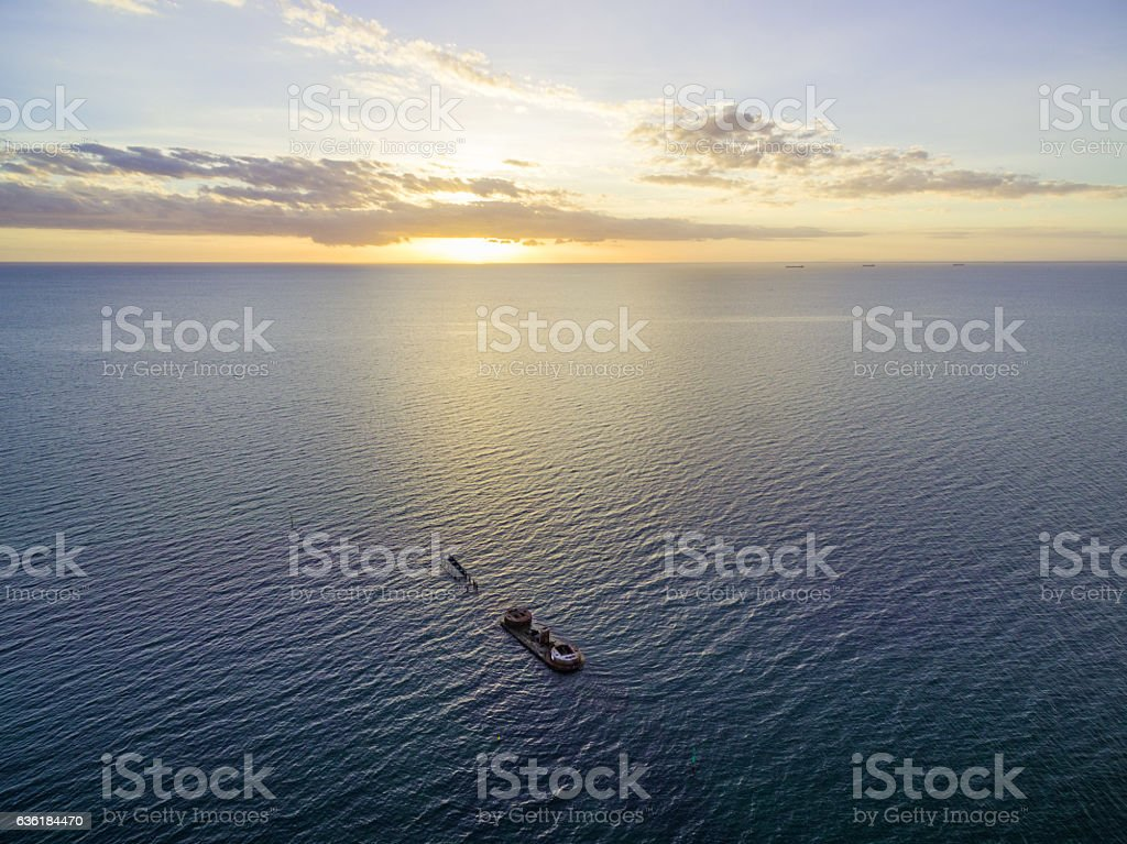 Aerial view of historic shipwreck of HMVS Cerberus at sunset. stock photo